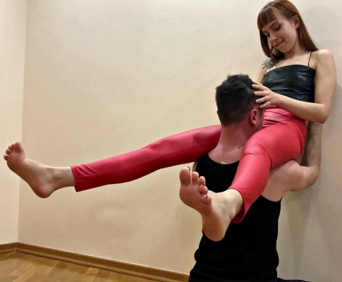 Goddess Kira In Red Leggings Tries Extreme Positions in Which Slave Should Worship Her Pussy