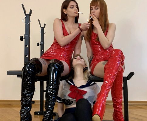 Two Mistresses In Latex Smoking And Uses Mouth Of a Slave Girl Like a Human Ashtray